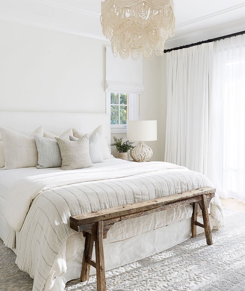 White bedroom with statement pendant light