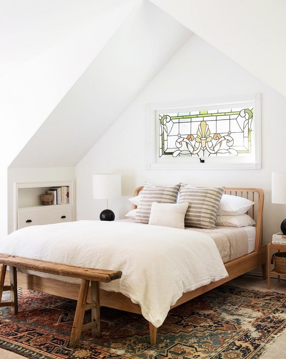 White bedroom with stain glass window