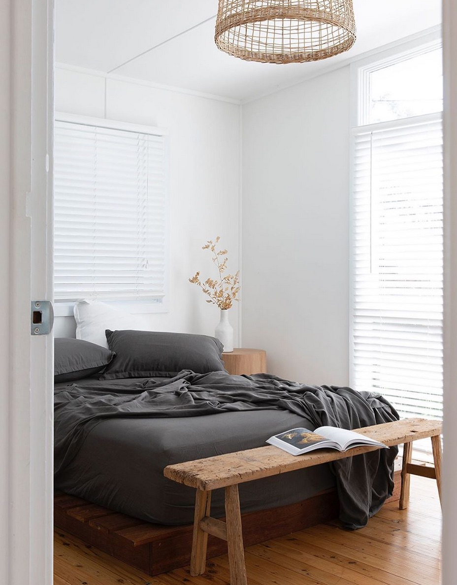 White walls and black bed sheets
