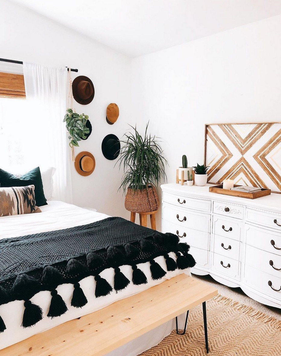 Boho bedroom with hat wall