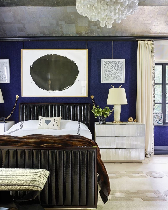 Black bed with blue bedroom walls