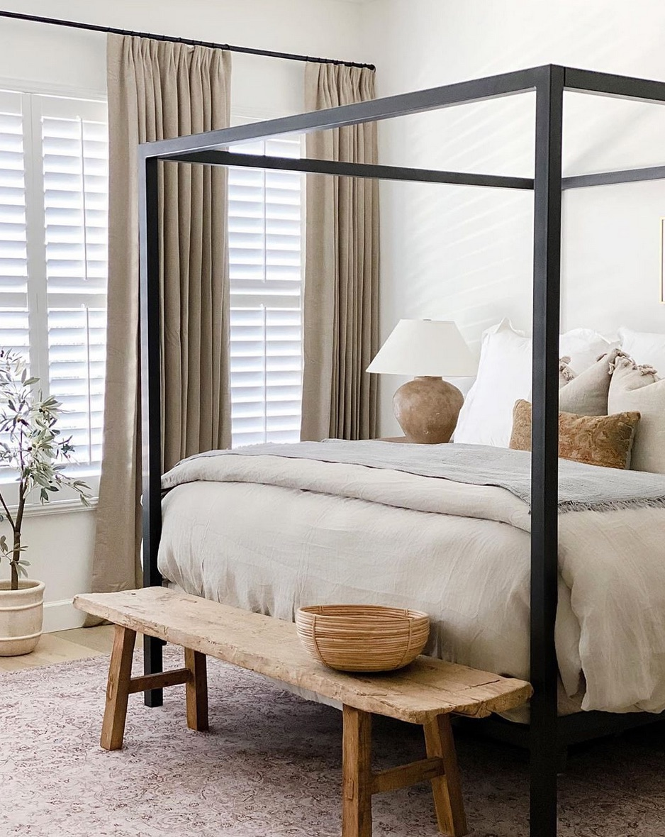 Black four-poster bed