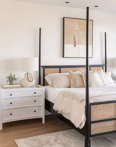 Black and rattan bed in white bedroom