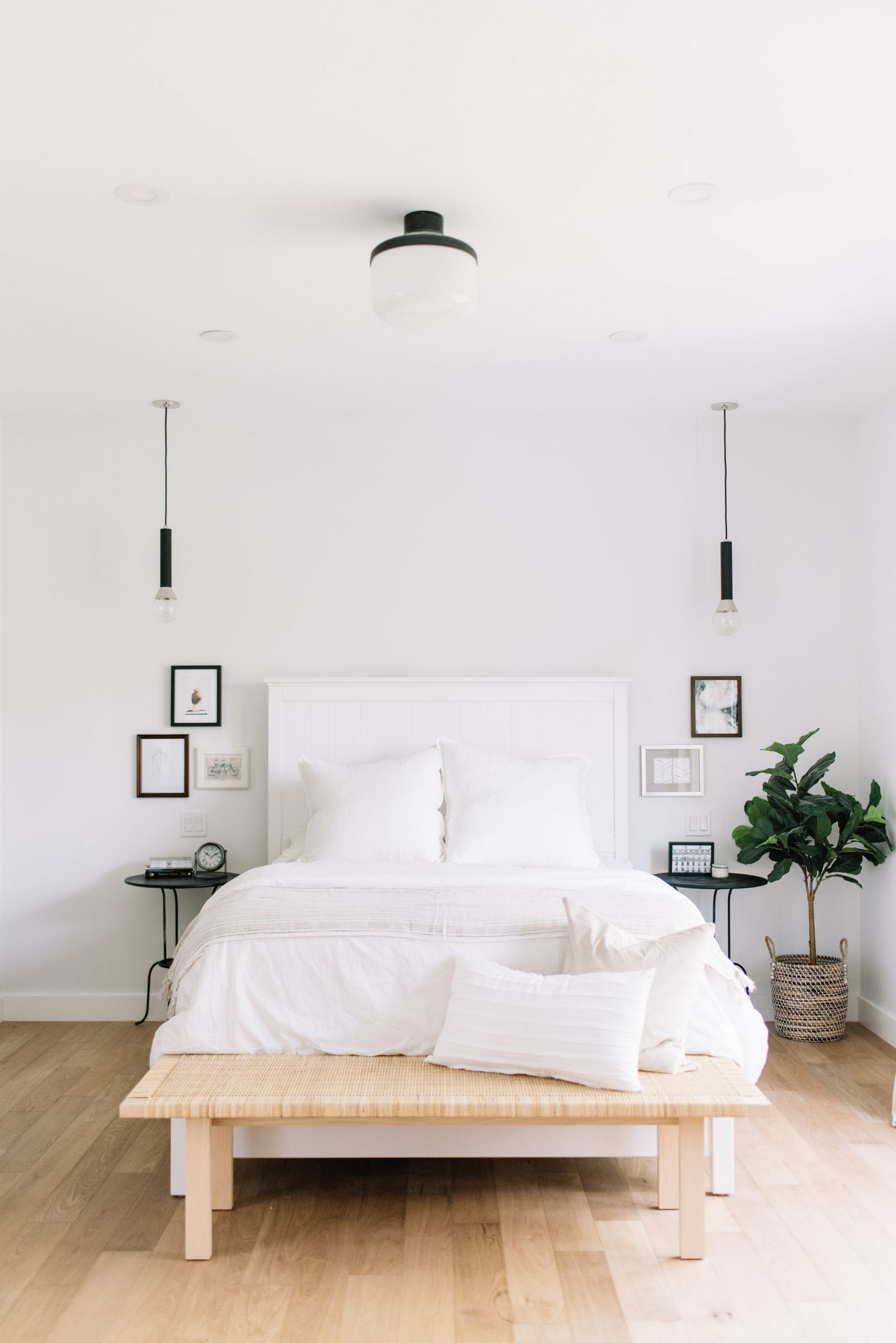 White bedroom with reading lights