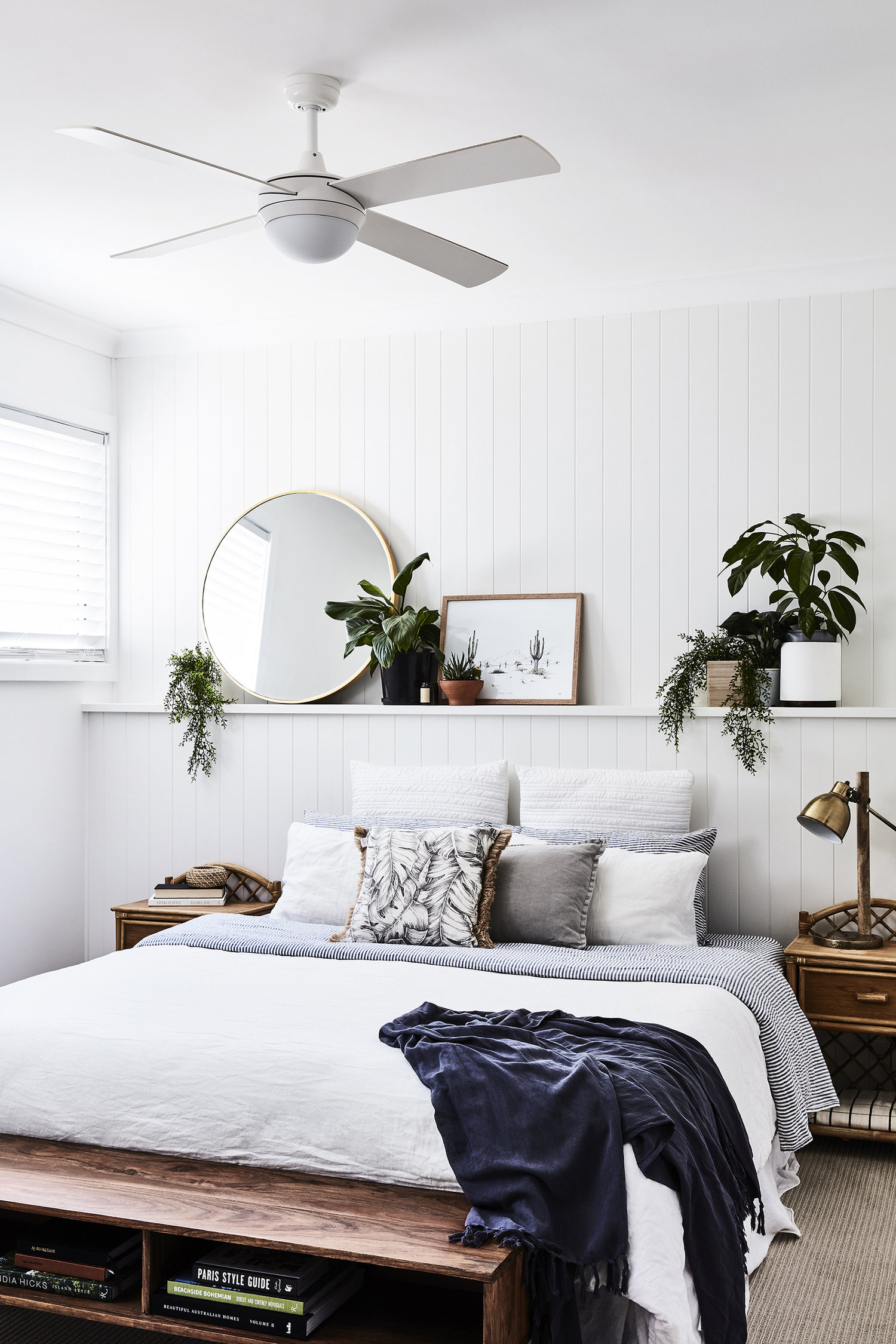 Floating shelf in bedroom with plants