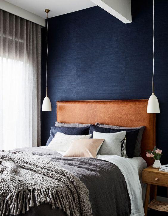 leather headboard in blue bedroom