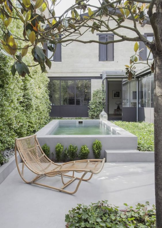 small backyard above ground white concrete