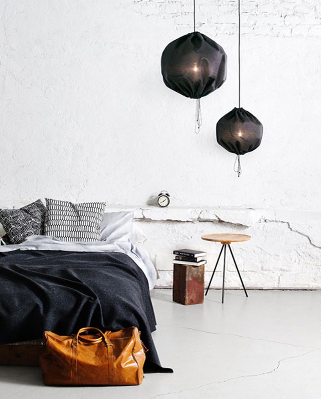 Black pendant lights in bedroom
