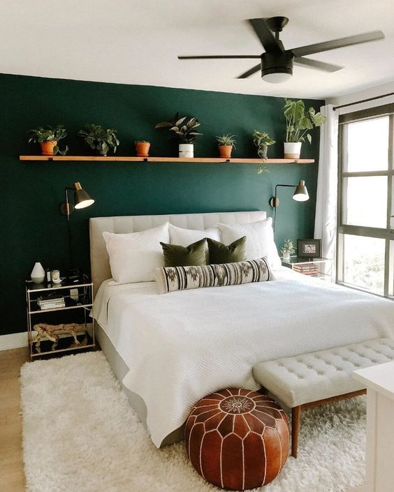 green bedroom with plant shelf