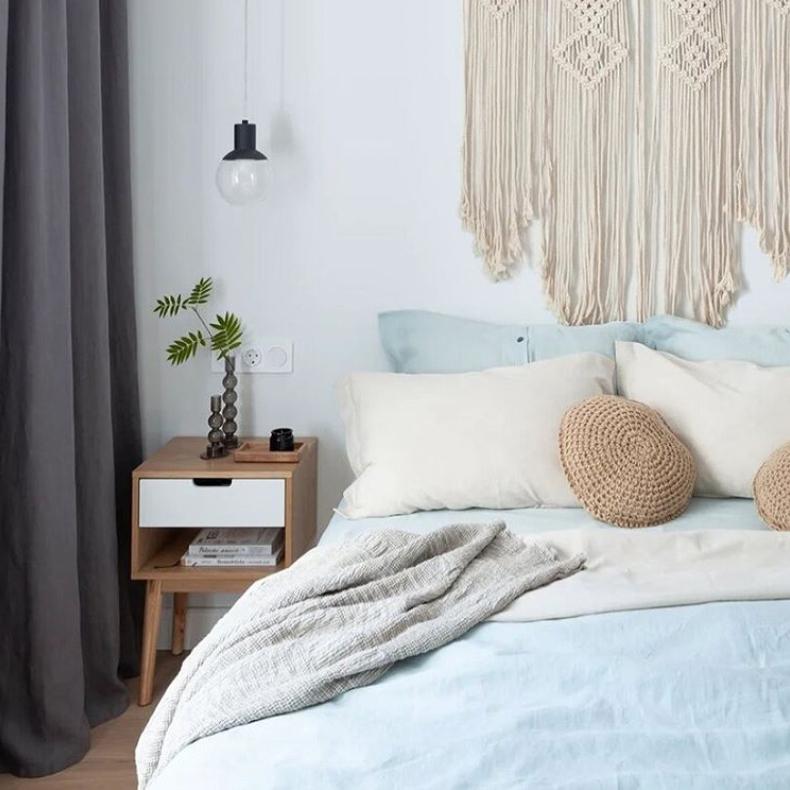 blue bedding in Scandinavian bedroom