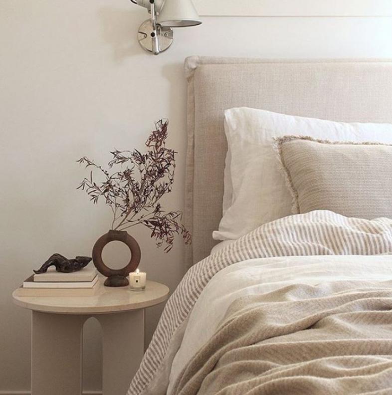 Linen bedhead in a Scandi bedroom