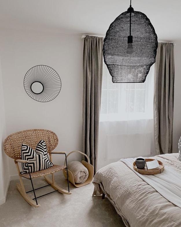 Black pendant light in a boho Scandinavian bedroom