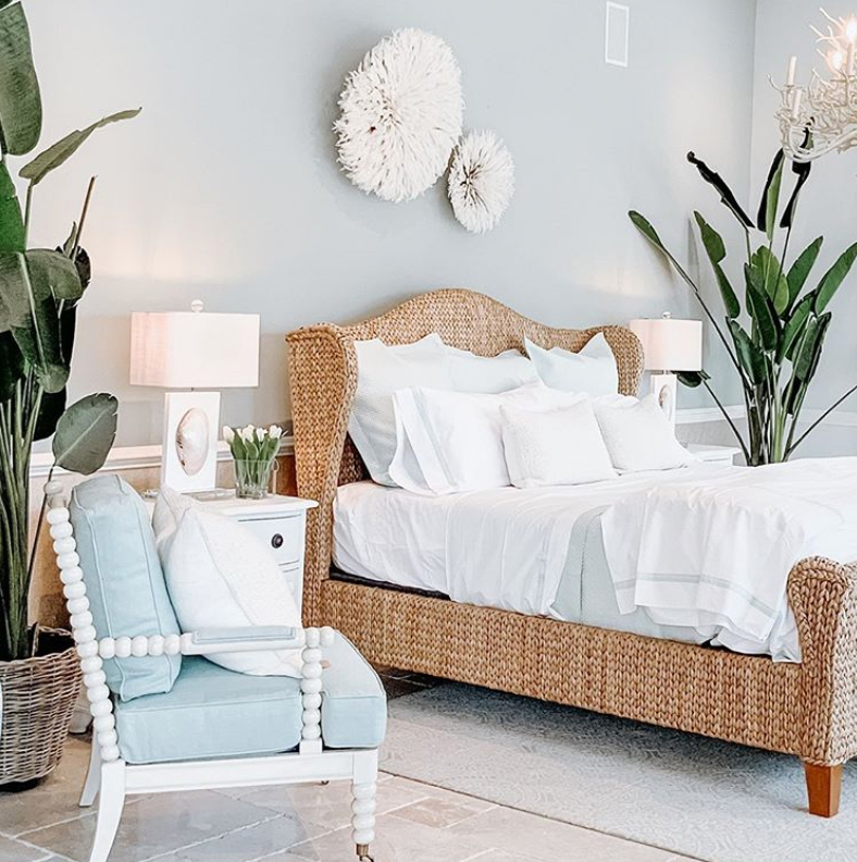 Rattan bedhead in blue bedroom