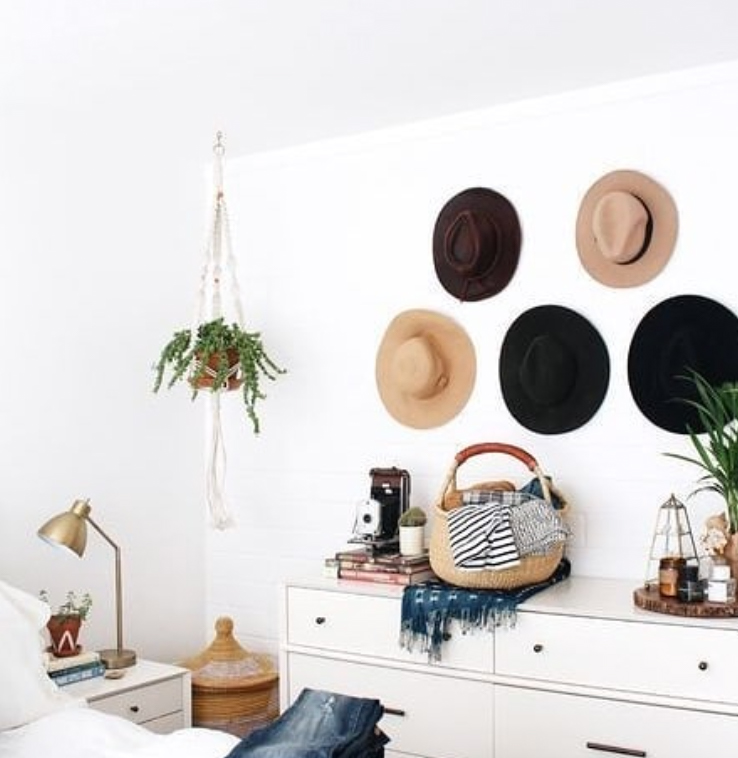Hats on a bedroom wall