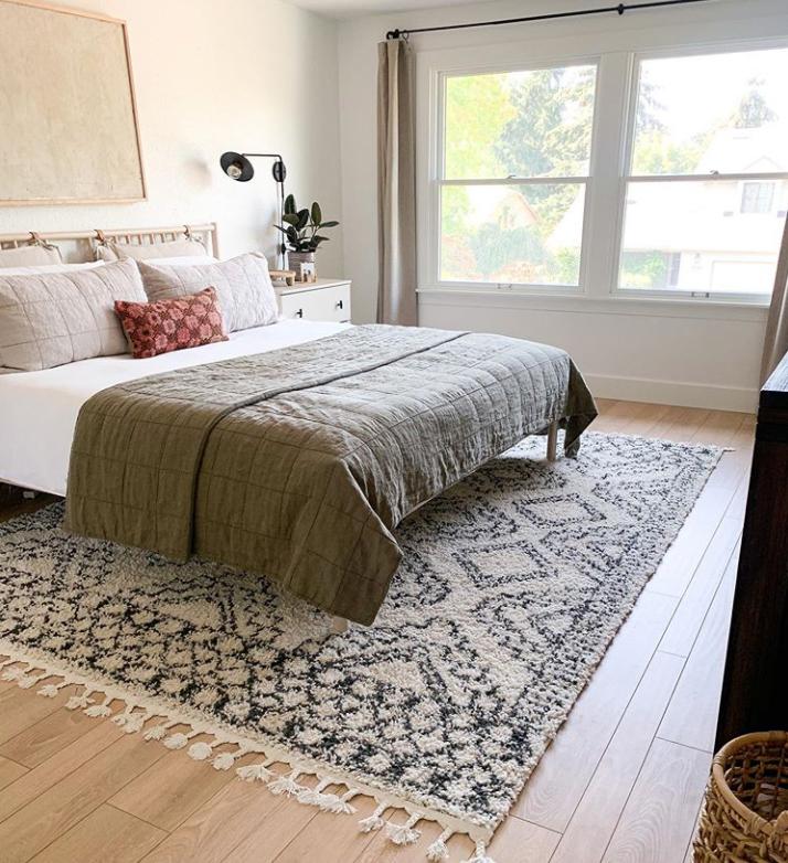 Rug under bed in bedroom