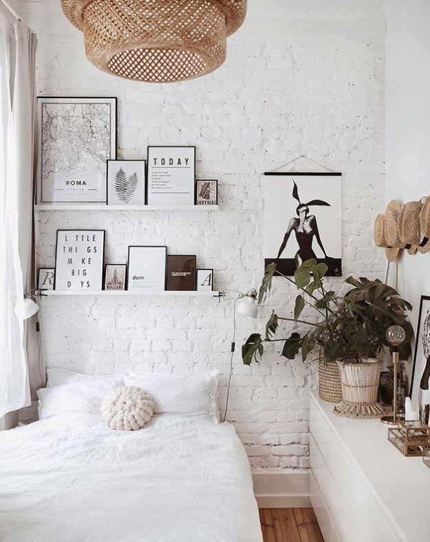 Painted brick wall in bedroom