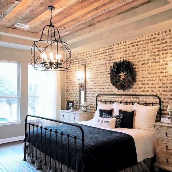 antique black bed in modern farmhouse bedroom