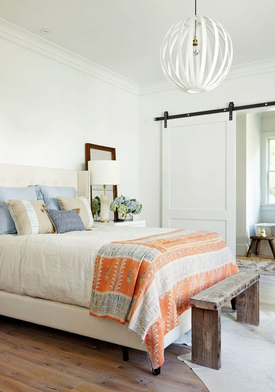 blue white and orange farmhouse bedroom