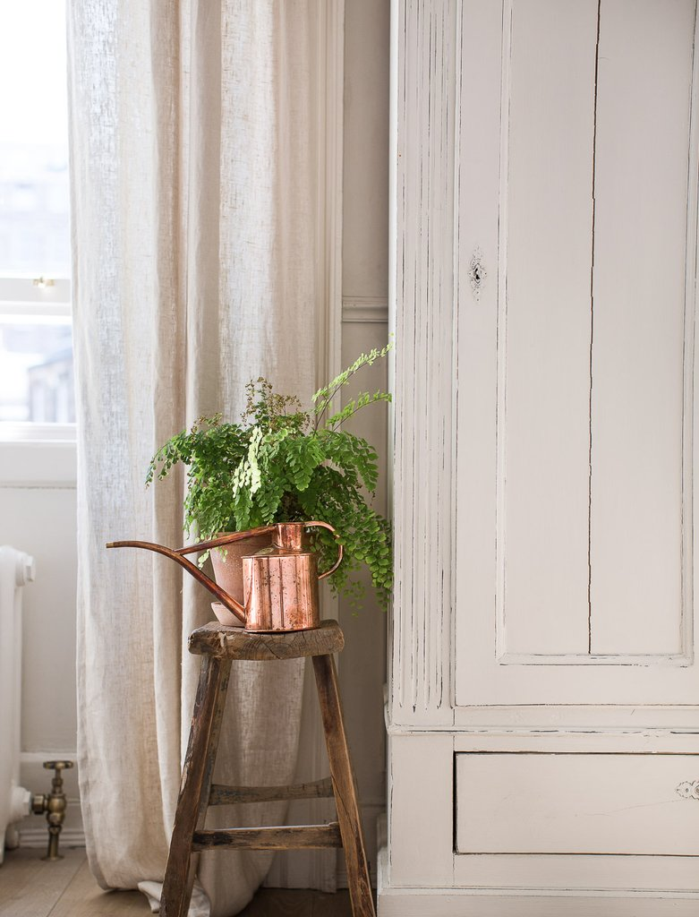 bedside watering can and old stool