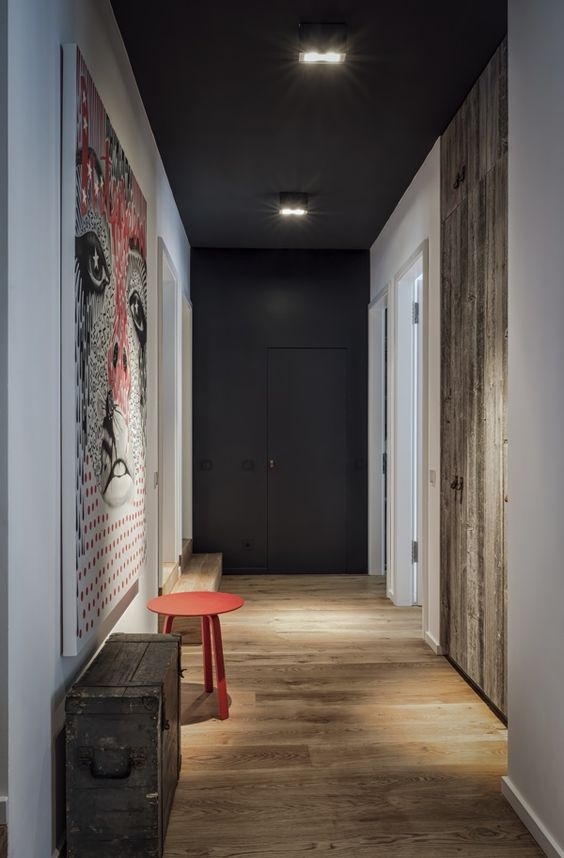 dark grey timber floors and pop of red