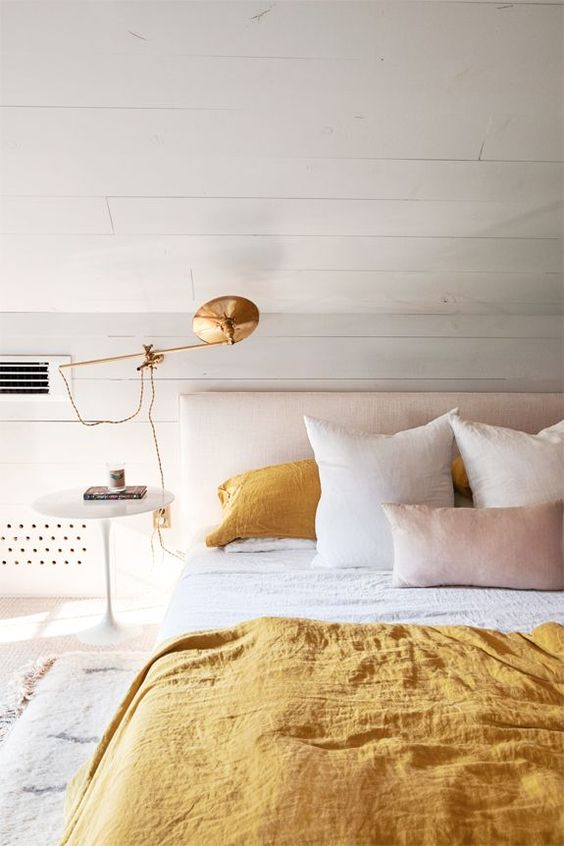 yellow bedroom with gold tones and shiplap