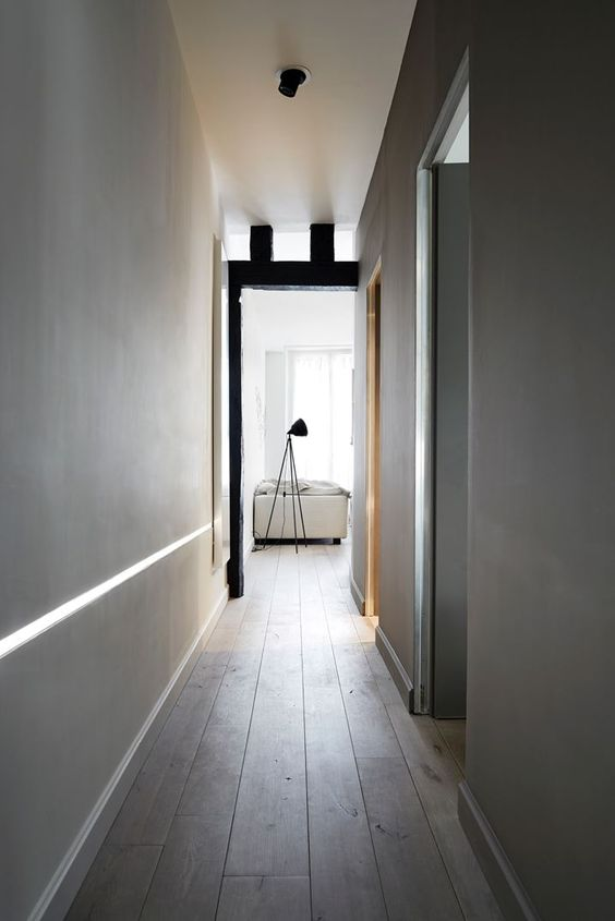 greys with black accents and timber floor