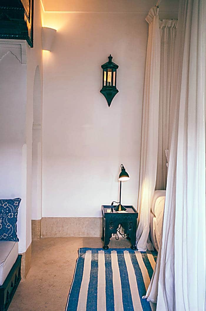 Moroccan white bedroom with blue accents