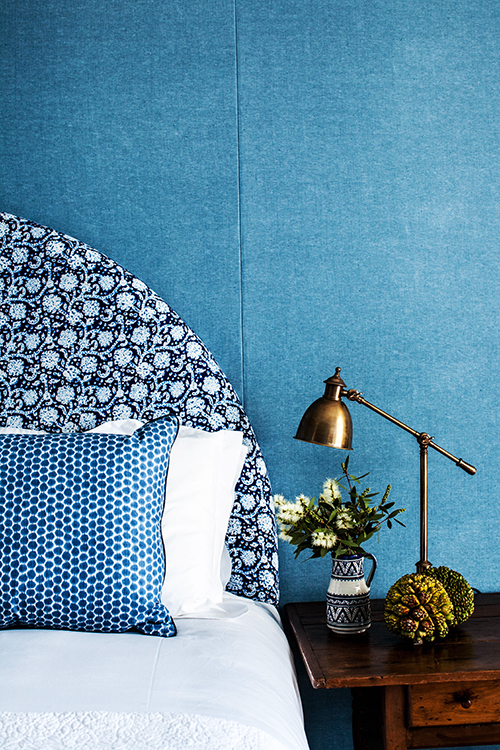 rose gold lamp and blue bedroom