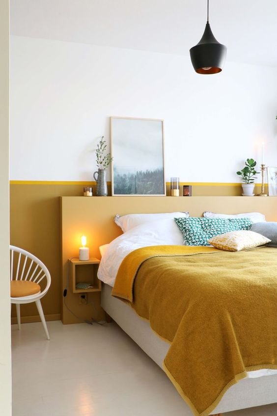 unusual headboard in yellow bedroom