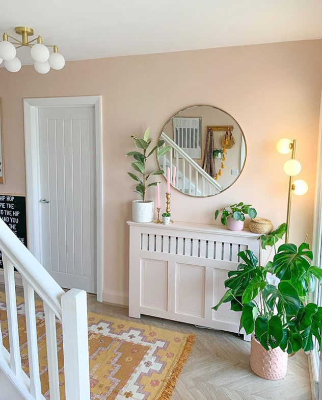Pastel pink wall in hallway