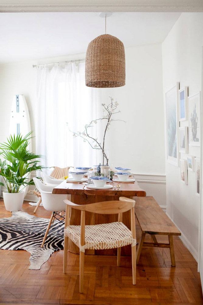 Boho dining room with a hide rug and rattan pendant