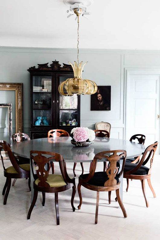 dark boho dining room with vintage elements