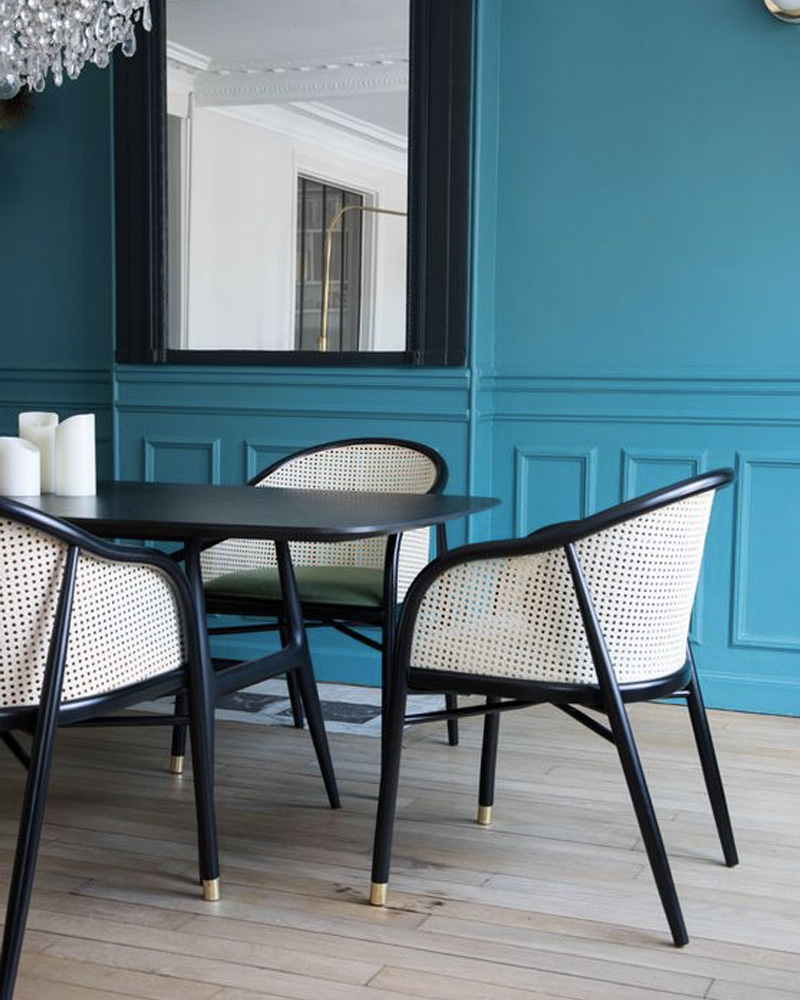 black cane chairs with blue walls