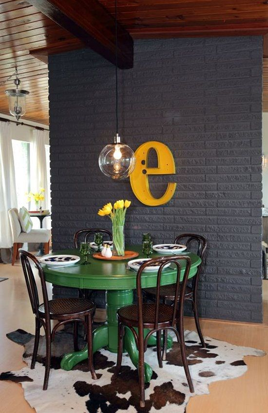 eclectic dining room with round green table
