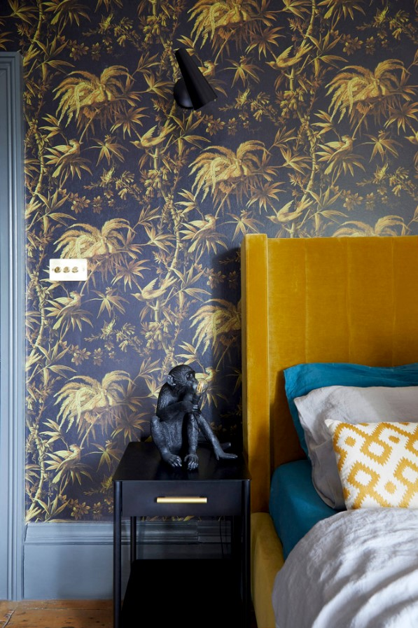 mustard bedhead with gold wallpaper