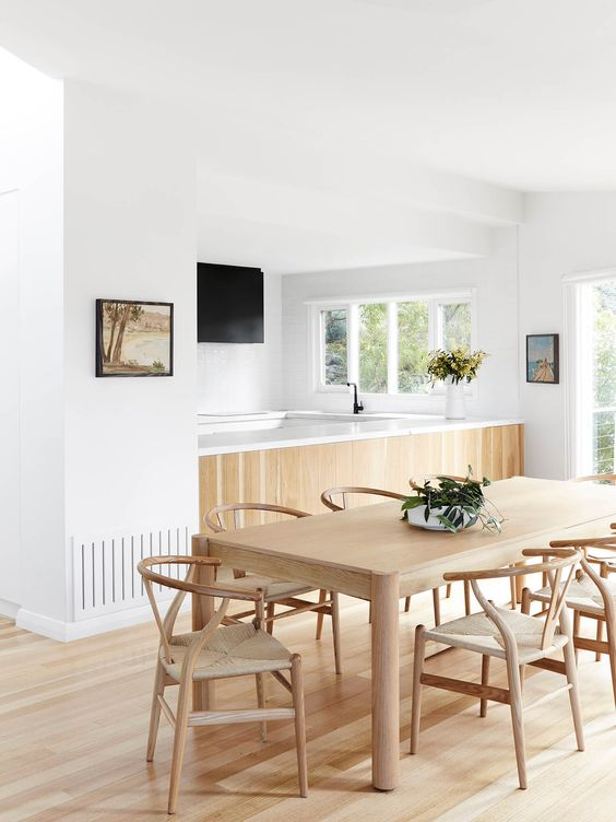 dining room with pale floorboards