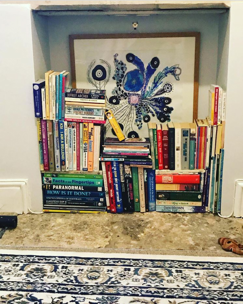 Books in an empty fireplace