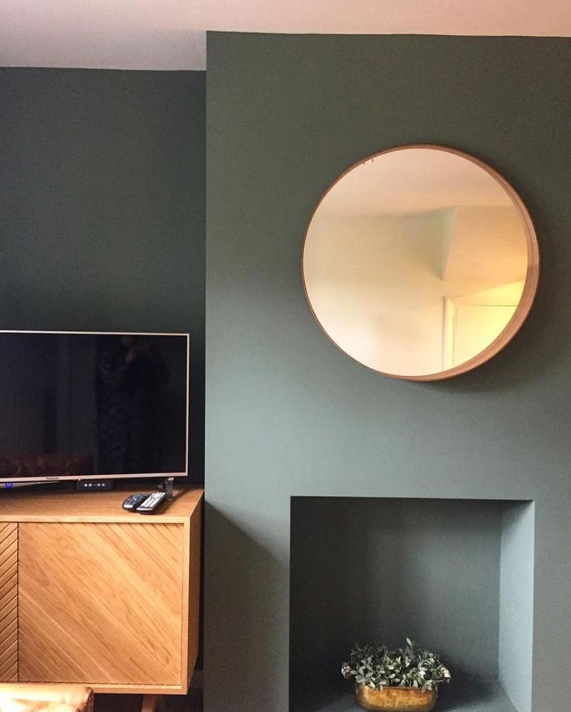 Green rendered modern empty fireplace