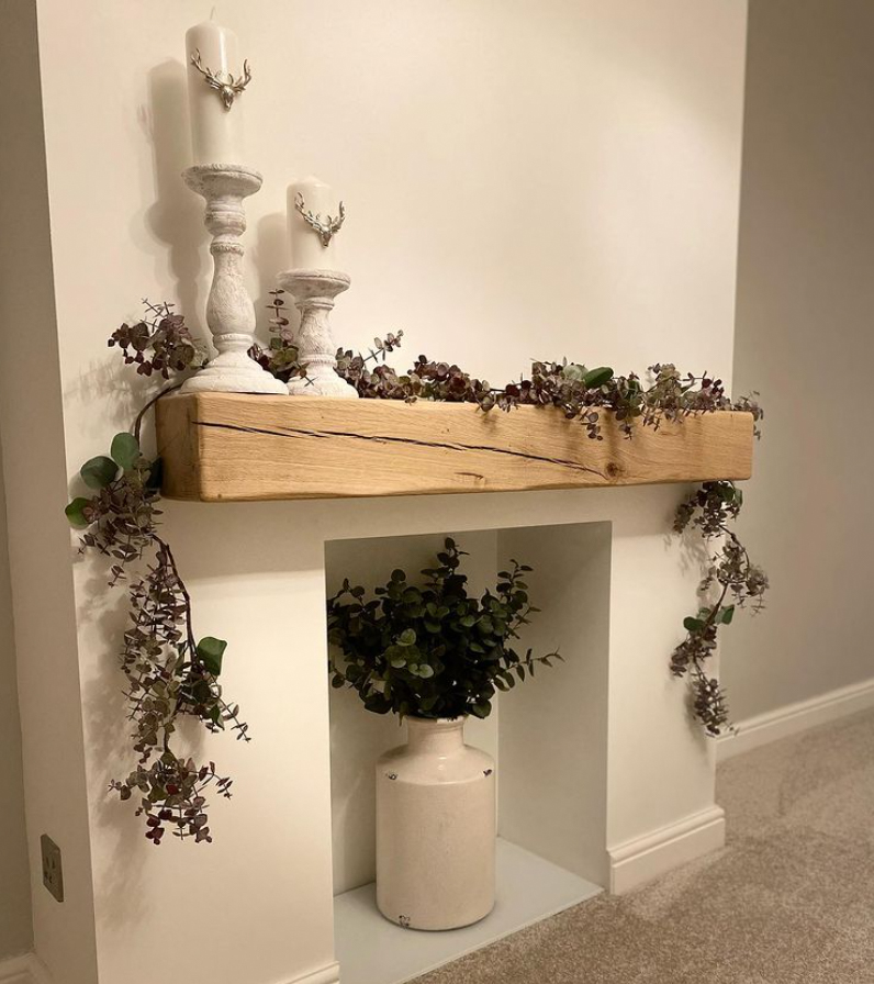 Fireplace with a vase and dried flowers