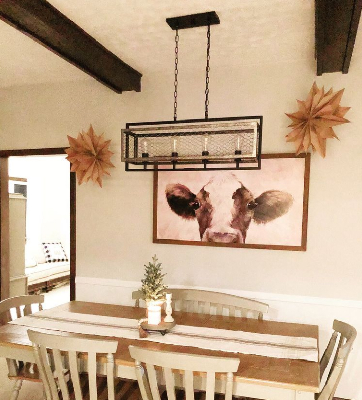 Minimalistic farmhouse dining room with cow painting