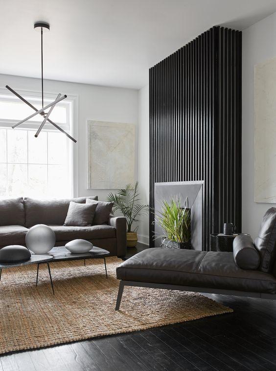black timber panelling surrounding fireplace