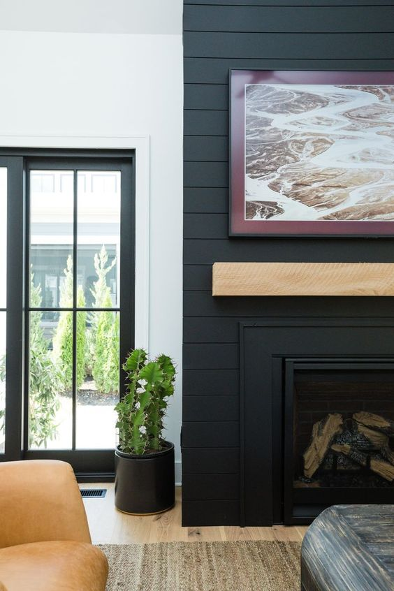 black fireplace with contrasting pale timber mantel