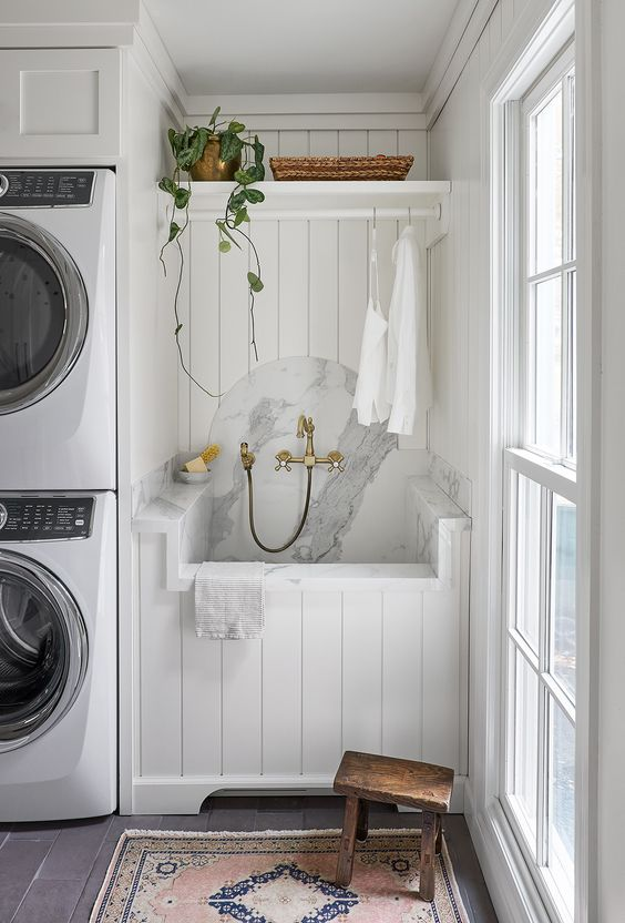 marble and shiplap utility room