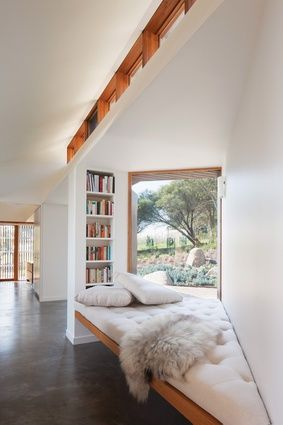 narrow bookcase with window seat