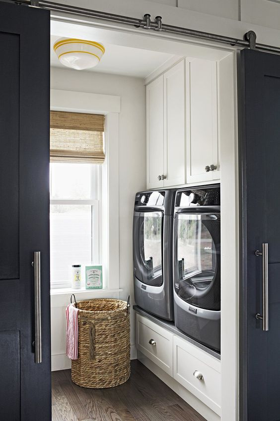 utility room with barn door
