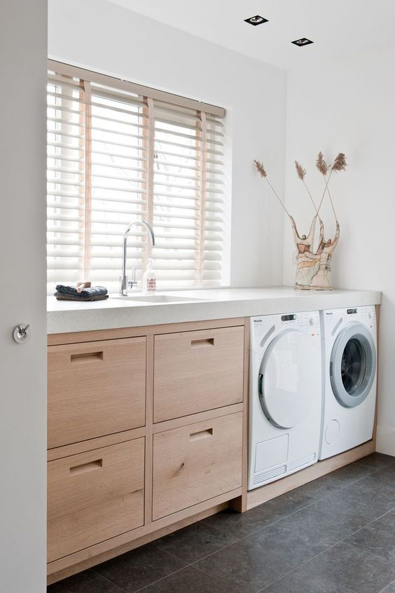 white and blonde wood utility room