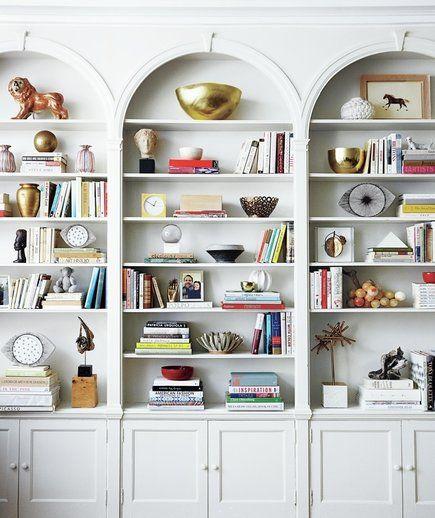 white arched bookshelves
