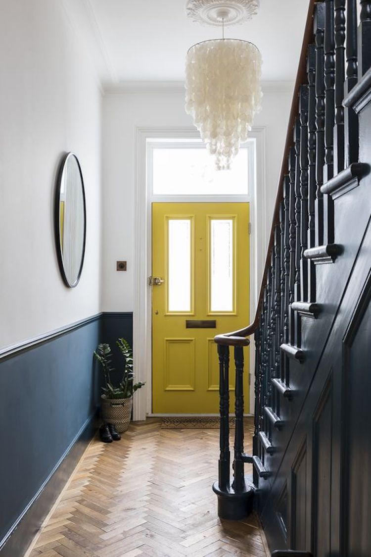 yellow-door-and-half-painted-wall-by-imperfect-interiors