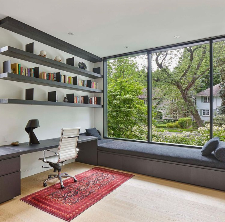 home office with a bench and large windows