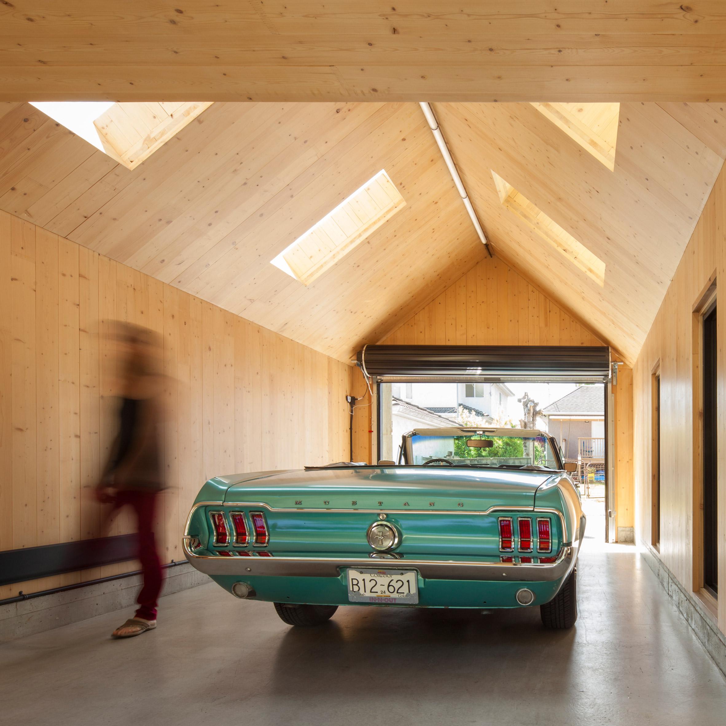 black roller door in timber garage